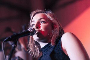 Louise Wellby hosting Jam Sandwich Live with microphone