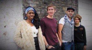 Soulmaze Band London - four musicians against grey brick wall